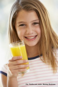 Young Girl Drinking Orange Juice